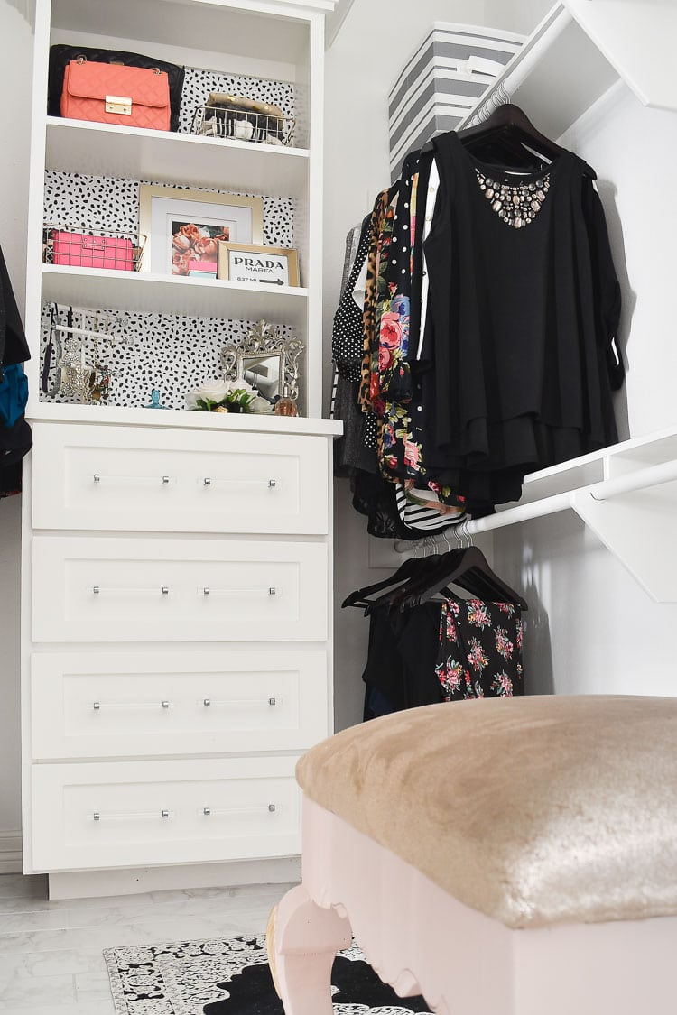 Master bedroom closet layout with white built-ins