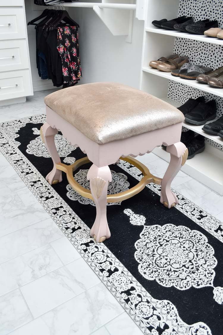 Rug and stool for seating in a master bedroom closet