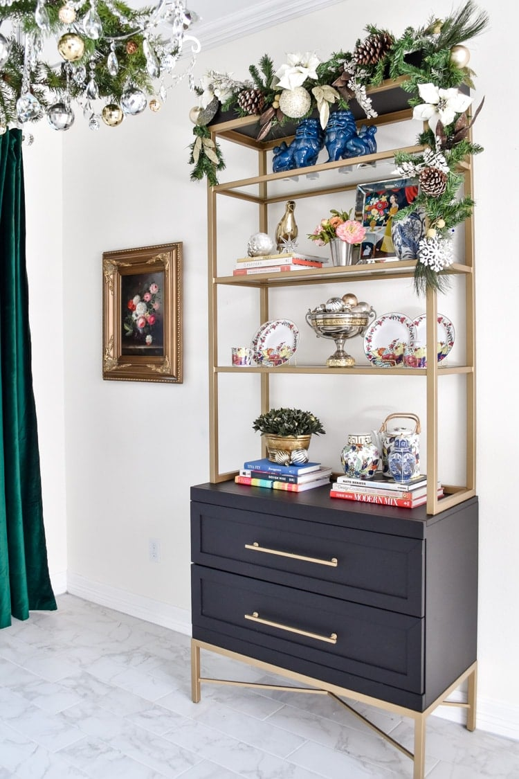 Black gold etagere styled in a dining room