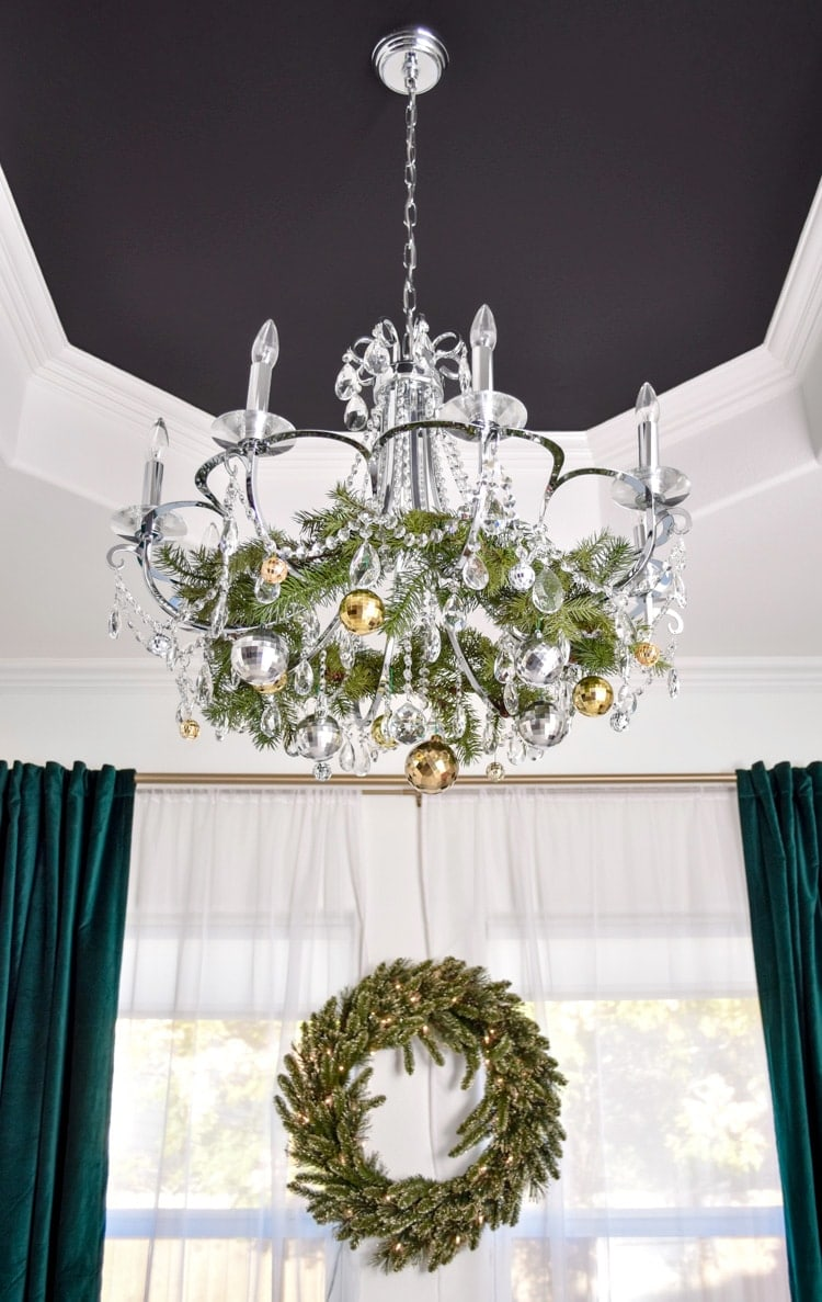Chandelier in a dining room decorated for Christmas