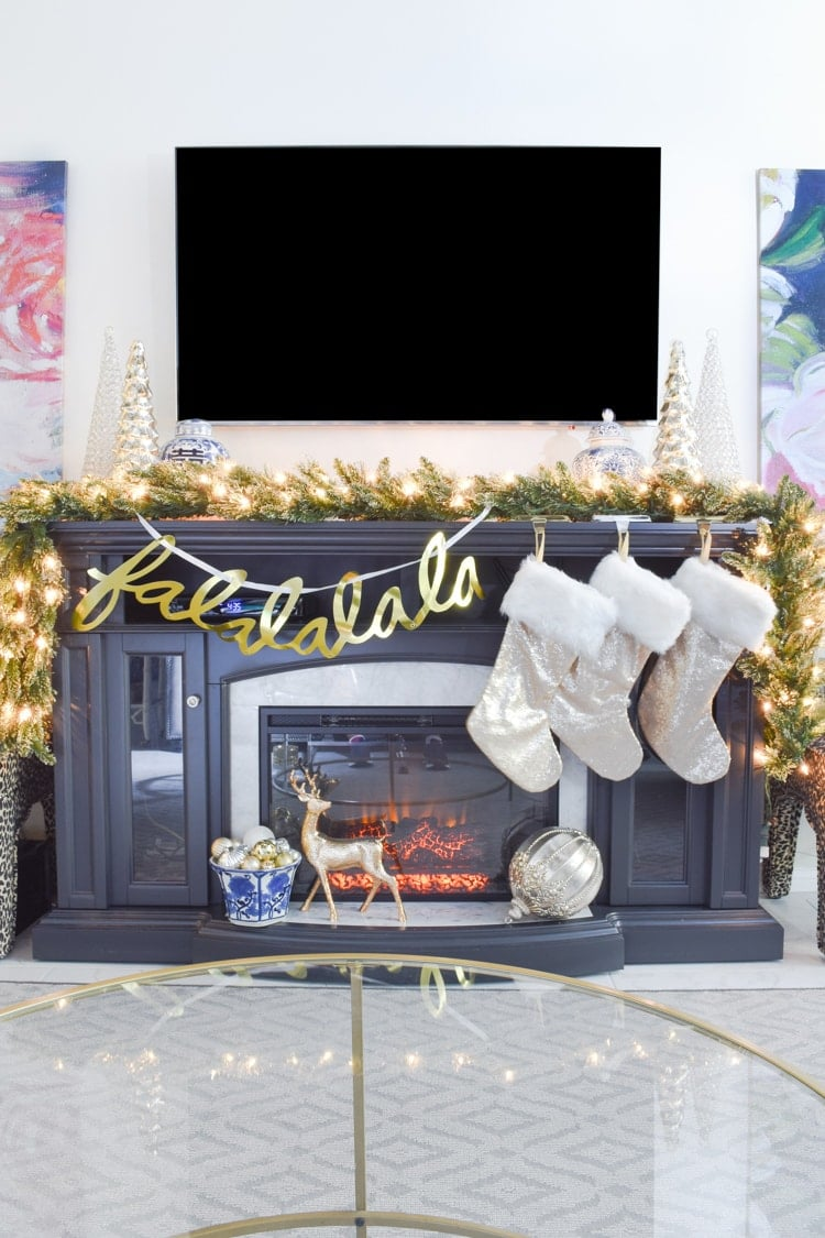 Gray fireplace decorated for Christmas