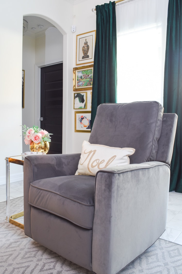 Gray recliner and green velvet curtains in a living room