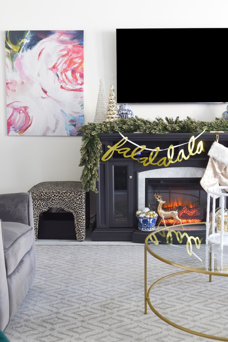 Leopard ottoman next to gray fireplace