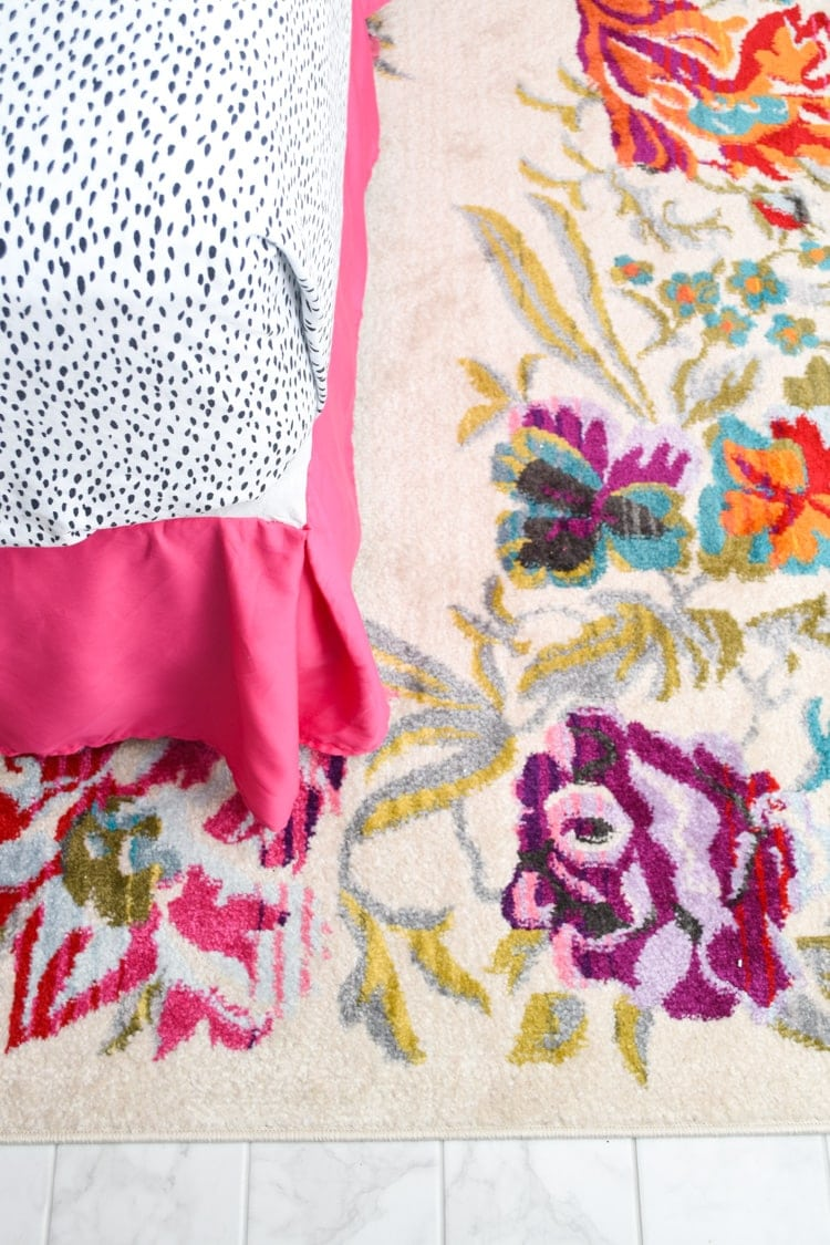 Floral rug and hot pink bed skirt