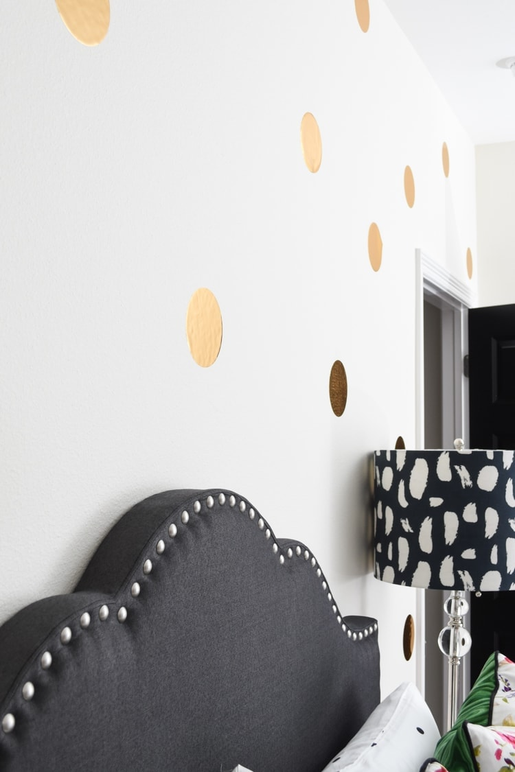 Polka dot accent wall guest room