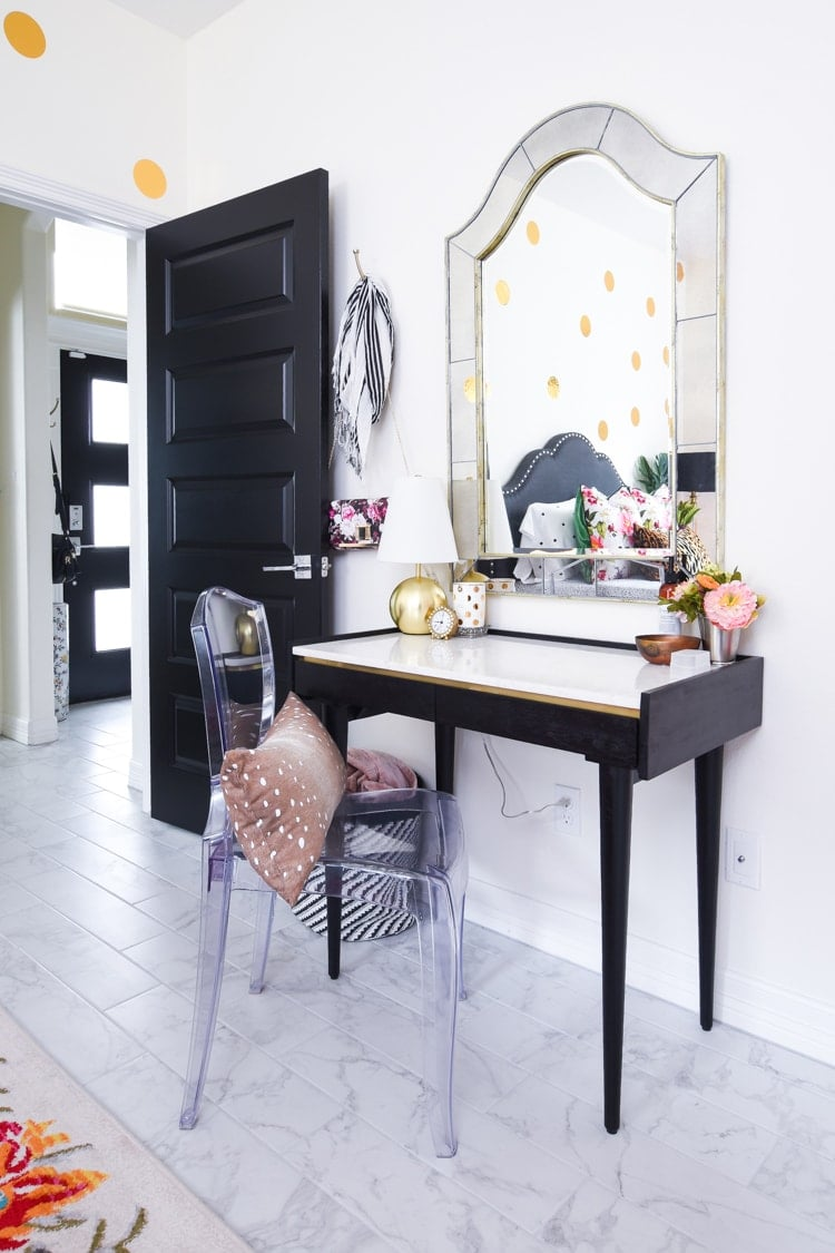 Black marble top desk in a bedroom for a home office